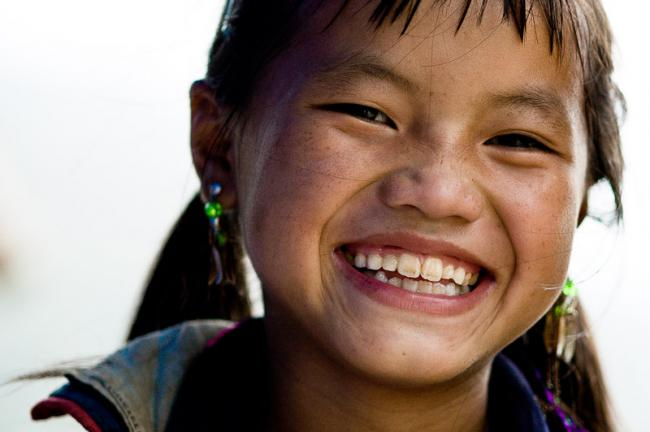 Black Hmong child delivering another smile, Sapa, Vietnam