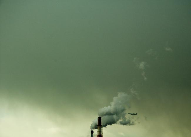 Airplane and smoke from chimney, Osaka