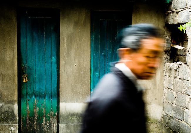 Man and green doors, China