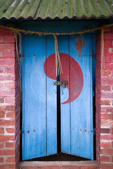 Door with yin yang symbol, Korea. A shamanist ritual house.