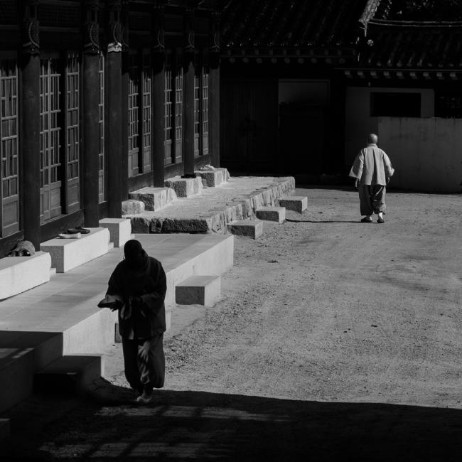 Two monks in temple yard