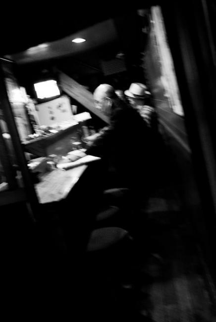 Men sitting in small restaurant, Shinjuku