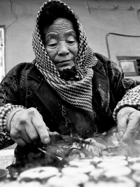 Woman making street food
