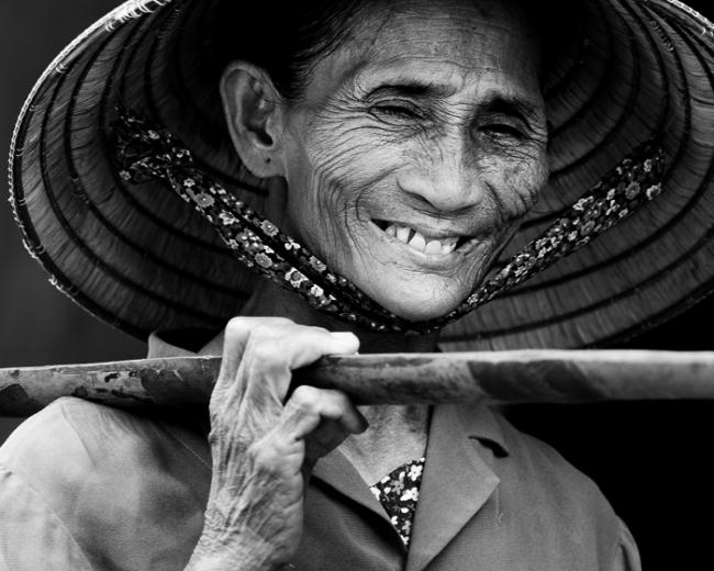 Portrait of a smiling vietnamese woman of age