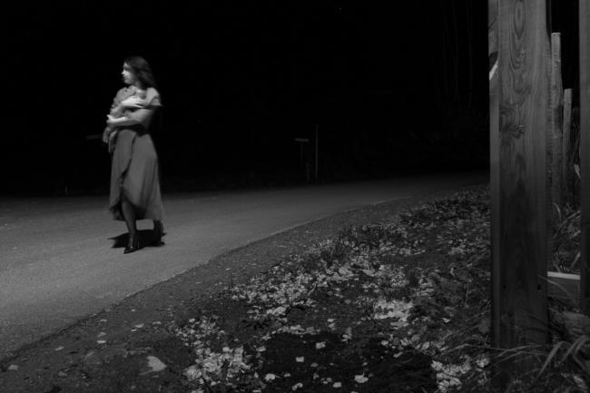 Woman walking in dark street