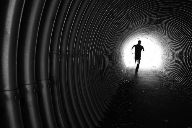 Man running in tunnel
