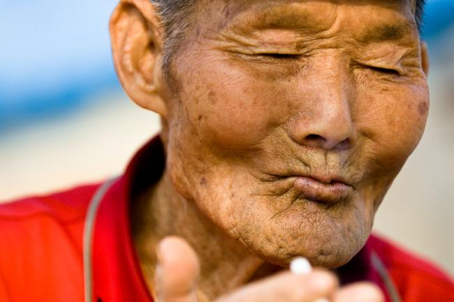 Korean man enjoying a cigarette, indeed