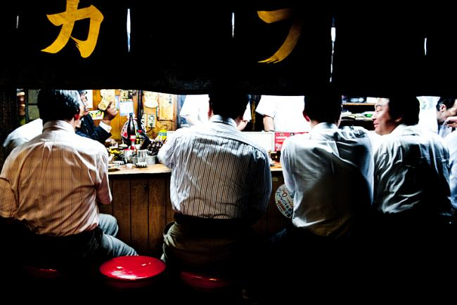 Japanese business men performing after-work ritual