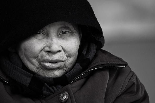 Portrait of a Korean woman with hood
