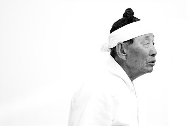 Korean man in traditional white clothing
