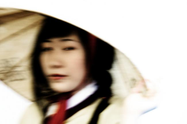Korean woman in hat and red bandana going somewhere